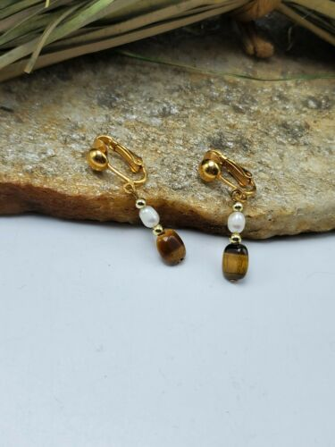 Earings 1950/'s clip on Ornate goldtone framing a tigers eye stone centre.