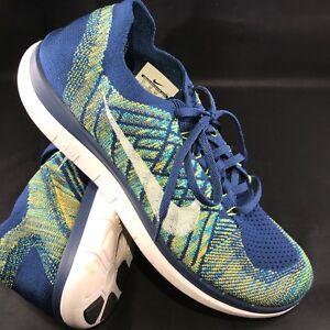 260a2a99bba7 Nike 4.0 Flyknit Men s Running Shoe Brave Blue Volt Navy Sz 11 45 ...