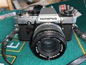 Reflex argentique Olympus OM-10 + Zuico F50 1,8  excellent & fonctionnel