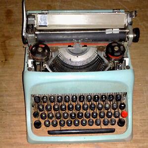 OLIVETTI-STUDIO-44-macchina-da-scrivere-vintage