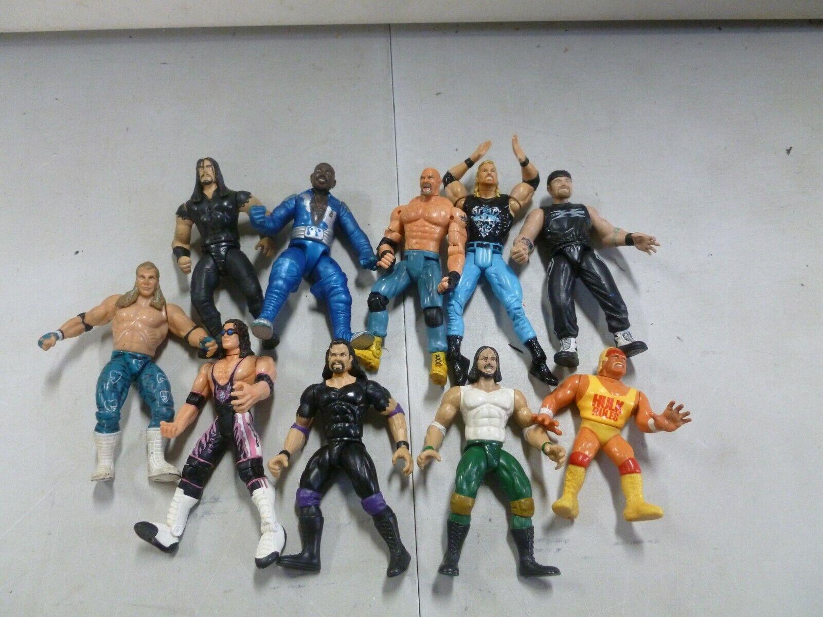 Lot of 10 Assorted Action Wrestling Figures goldberg, Hulk