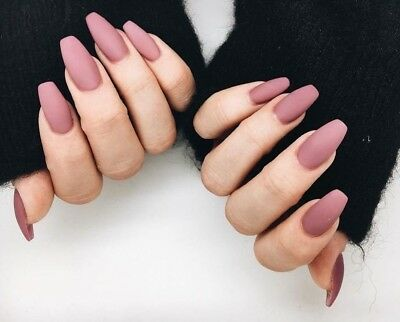 putting on fake nails  nail and manicure trends