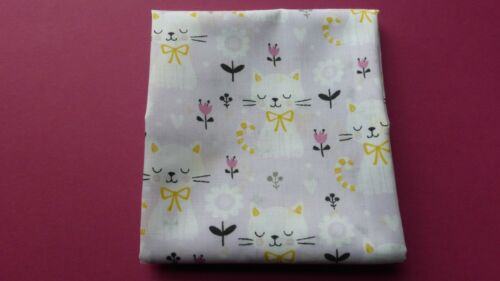 1 metre of polycotton with white cats and flowers with black decoration on lilac