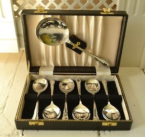 Boxed A1 EPNS  plated serving spoon and 6 x dessert spoons