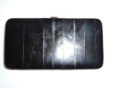 genuine eel skin wallet with metal frame for women.