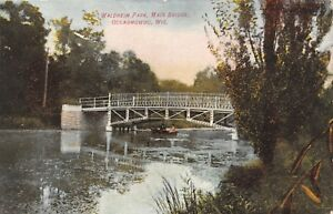 Oconomowoc-Wisconsin-Waldhiem-Park-Row-Boat-Under-Main-Bridge-1908-Postcard