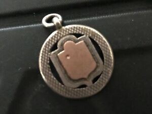 Silver & Gold Round Fob with Gold Shield . Ref 003