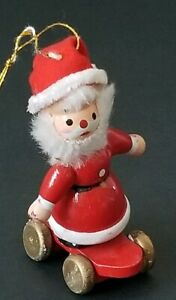 VINTAGE-1977-KURT-ADLER-CHRISTMAS-WOODEN-ORNAMENT-SANTA-RIDING-A-SKATEBOARD