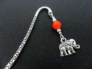A TIBETAN SILVER ORANGE JADE BEAD  & ELEPHANT CHARM BOOKMARK. NEW.