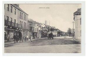 Jersey-postcard-St-Aubin-Street-scene-showing-shops-amp-horse-amp-carts-A22