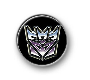 TRANSFORMERS-1-25mm-pin-button-badge-Marvel-Autobots-Decepticons