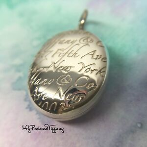 c07fb133c4fb0 Details about Authentic Excellent Tiffany & Co Notes Script Oval Locket 5th  Fifth Avenue Charm