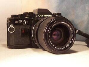 olympus OM 10 avec  zoom minolta 35x70 mm