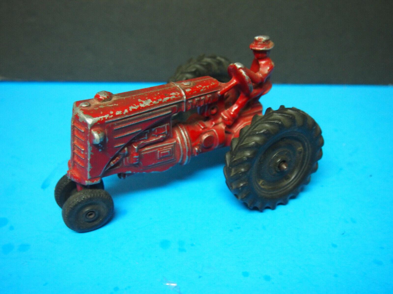 Antique Hubley Farmall 7  Cast Aluminum Tractor with Driver,