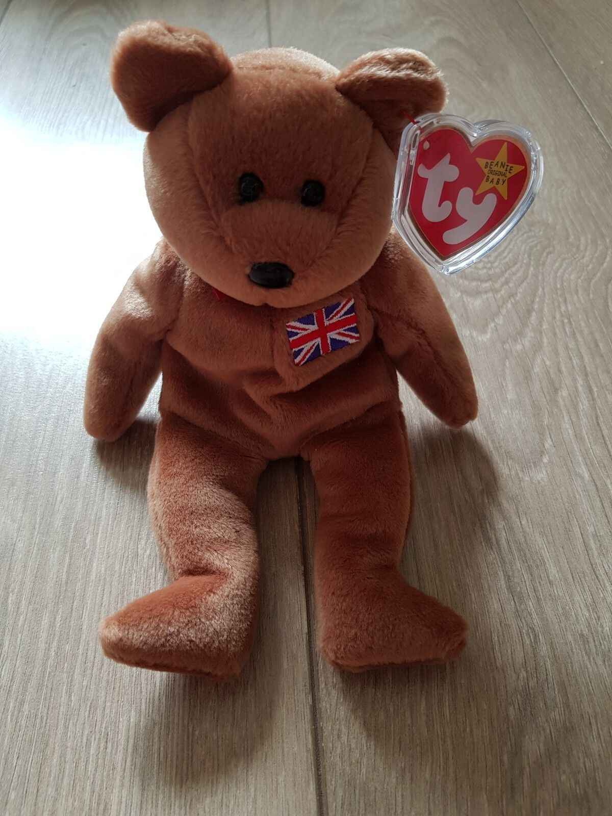 Ty beanie baby 'BRITANNIA' the bear. has a  RARE  red stamped  tush tag.