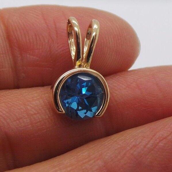 STUNNING 14K YG blueE TOPAZ PENDANT  E16596-2  2.13 grams
