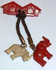 Un elefante de plástico Vintage casa y dos elefantes Broche