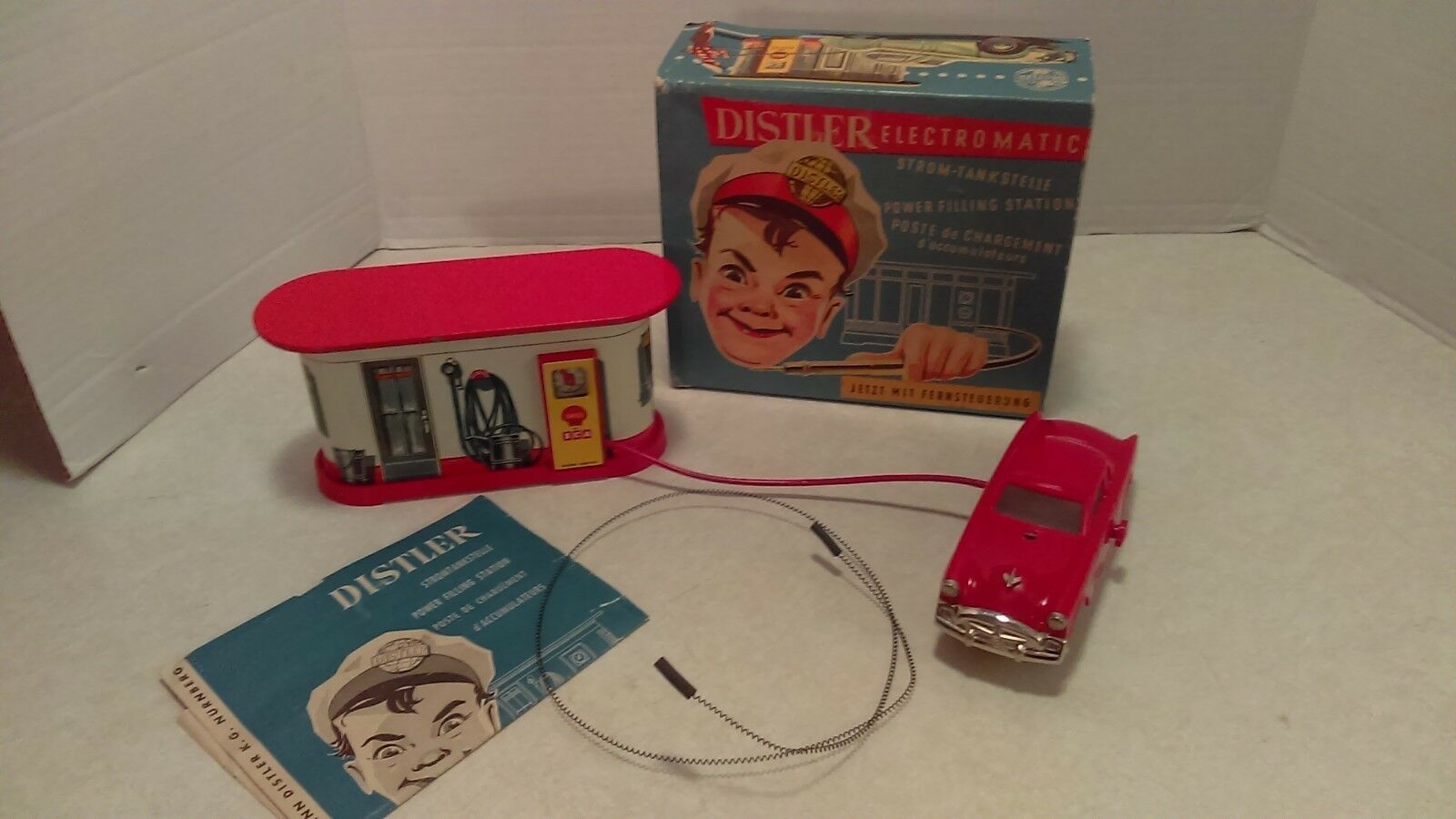1950's 1950's 1950's Distler Electromatic Battery Operated Auto Filing Station Studebaker NMIB 7d5ff7