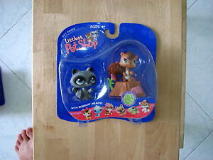 BNIB-LITTLEST-PET-SHOP-RACCOON-AND-SQUIRREL-WITH-TREE-TRUNK-195-amp-196