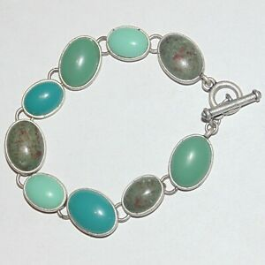 Multi-shade-faux-turquoise-oval-cabochon-matte-silver-tone-toggle-clasp-bracelet