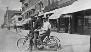 Early original negative of a 2 guys on a MERKEL LIGHT motorcycle - street scene