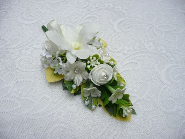 Wedding flower buttonhole ivory orchid....PIN ON