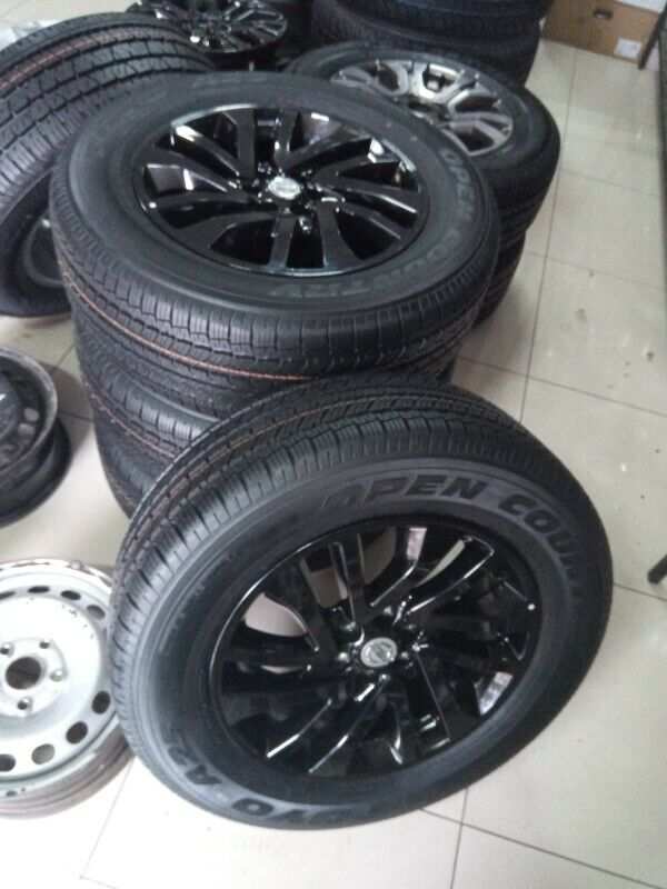 "18"" Black Nissan Navara mags with brand new 255/60/18 Toyo Open Country set for R11500."