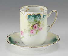 2pc RS Prussia Demitasse Cup and Saucer. Raised designs hand painted gilt floral