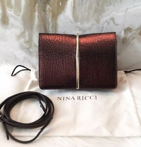 9a42216a4743 Image is loading Nina-Ricci-Small-Bronze-Arc-Crossbody-Clutch-Bag