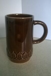 Brown-pottery-mug-by-Holkham-Pottery-in-England