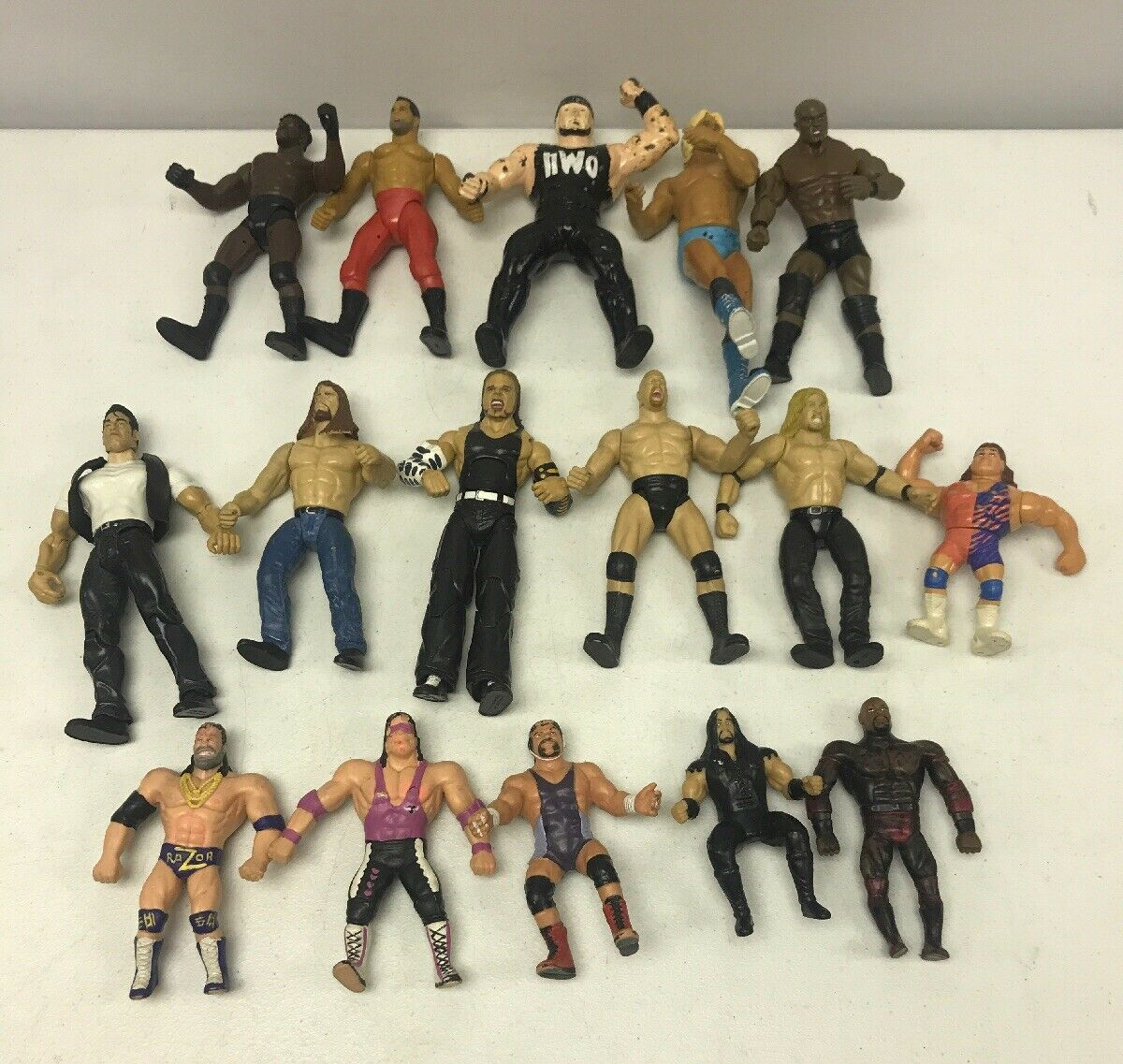 Lot of 16 Vintage 1990-2007 WWE Action Figures