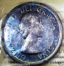TONED BOTH SIDES  ,WILD COLOURS. CANADA 1954 SILVER DOLLAR .  HIGH GRADE