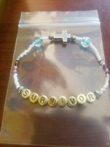 handmade-womens-unique-gold-034-survivor-034-silver-cross-glass-bead-stretch-bracelet