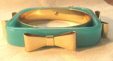 Lovely TED BAKER Seafoam Green Logo Bangle Bracelet With Bows Motif