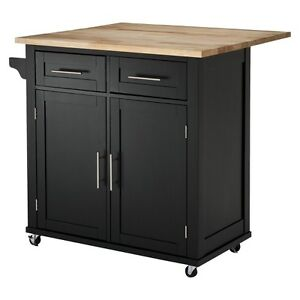 Large Kitchen Island With Wood Top And Storage Threshold