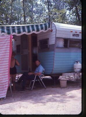 COUPLE UNDER AWNING OF CAMPER TRAVEL TRAILER 1960's PHOTO ...