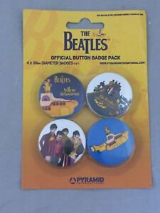 NEW-SET-OF-4-BUTTON-BADGES-THE-BEATLES-THE-YELLOW-SUBMARINE-MUSIC-PACKAGED