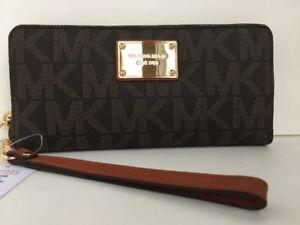 a019a5c19b60 MICHAEL KORS JET SET Travel Continental Brown Logo Wristlet Wallet ...