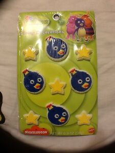 Wilton-Backyardigan-039-s-Icing-Decorations-Pablo-Stars-Cupcake-Cake-9-Pieces-NIP