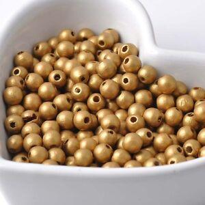 50-perles-en-bois-6mm-couleur-Dore-6-mm-creation-colier-attache-tetine