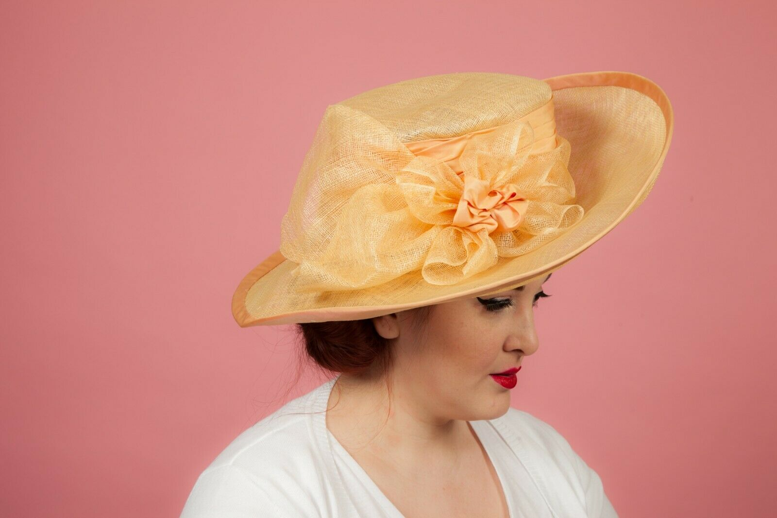 Oversized peach apricot coloured formal hat by Pamela Bromley