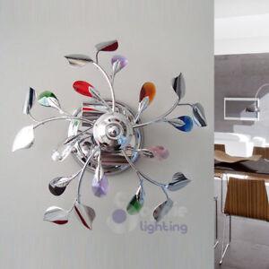 Applique-parete-lampada-design-moderno-acciaio-cromato-cristalli-colorati-salone