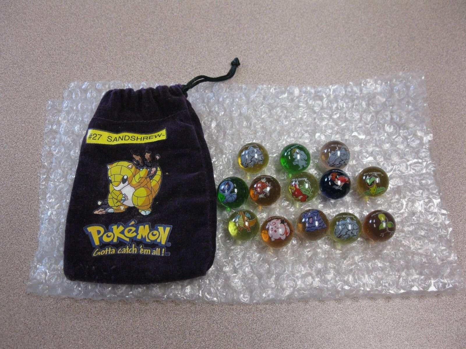 Lot Of 13 Collectible Vintage  Pokemon Glass Shooter Marbles Bag  27