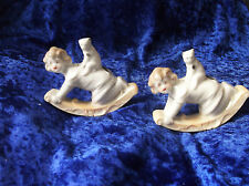 2 X VINTAGE LUSTRE GLAZE GIRLS KNEELING ON ROCKER WITH CAT ON BACK FIGURINES