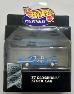 """100/% HOT WHEELS  /""""57 OLDSMOBILE/' BOXED WITH DISPLAY CASE YELLOW AND BLACK"""