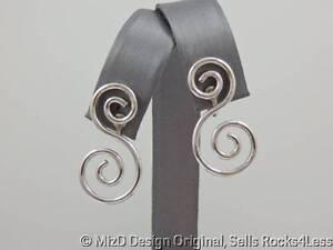 Avon-Double-Silver-Swirl-S-Shaped-Earrings-Clips