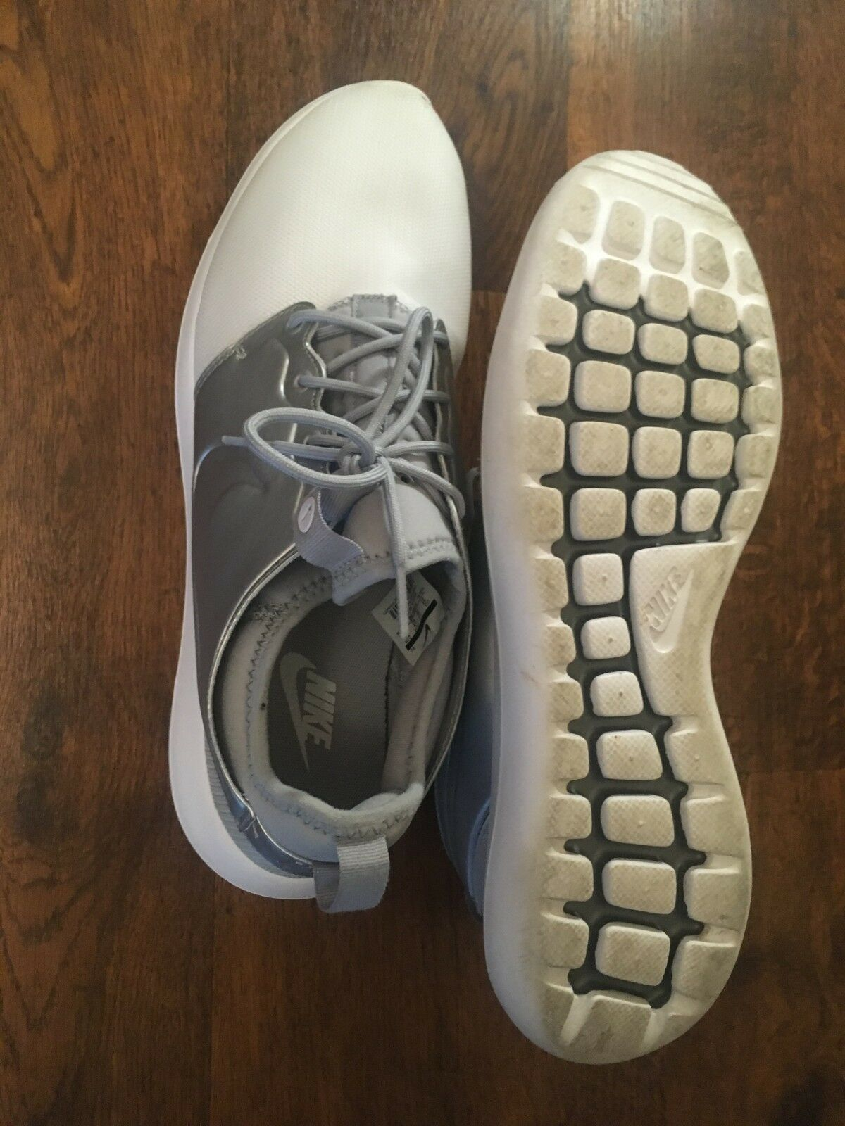 Silver Nike Roshe 1s with defects. Size 11