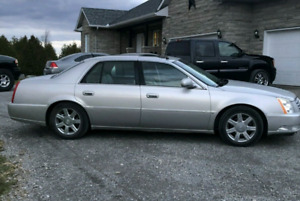 CADILLAC DTS RUNS AND DRIVES LIKE NEW AND WINTERS TOO