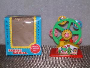 VINTAGE YONEYA (YONE), PLASTIC/TIN, FERRIS WHEEL CLOCKWORK W/ORIGINAL BOX. WORKS