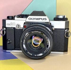 Olympus-OM-20-35mm-SLR-Film-Camera-con-50mm-1-1-8-Zuiko-Lens-BAG-EXTRA-vintsgr